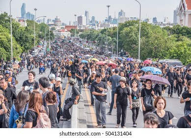 Bangkok, Thailand - October 22,2016 :Thai people come for singing the anthem of His Majesty King Bhumibol at Pinkhao bridge near the Royal Palace to pay respect for the king in Bangkok, Thailand.