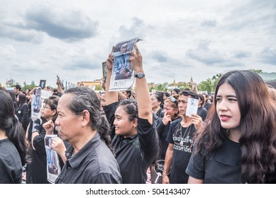 Bangkok, Thailand - October 22,2016 :Thai people singing the anthem and hold the portrait of His Majesty King Bhumibol at Sanam Luang in front of the Royal Palace to pay respect in Bangkok,Thailand.