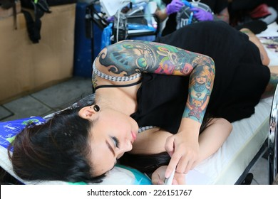 """BANGKOK, THAILAND - OCTOBER 23: Unidentified contestant's tattoo at MBK Center """"MBK TATTOO CONTEST 2014 Vol.9 THAI INK RETURN"""" on October 23, 2014 in Bangkok, Thailand"""