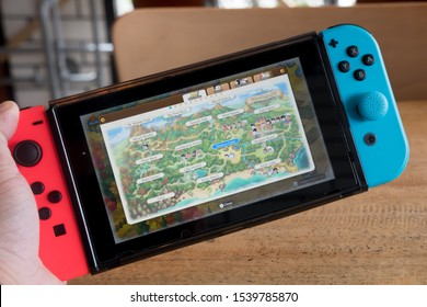 Bangkok, Thailand - October 24, 2019: Man playing game of Doraemon Story of Seasons in Nintendo Switch. The game combines the farming simulator elements from the Story of Seasons series and Doraemon