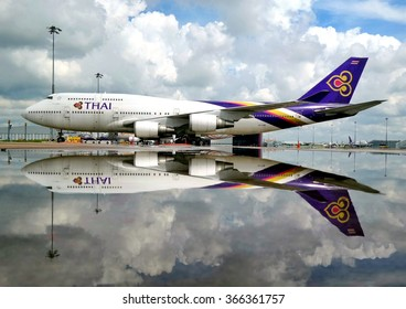 Bangkok Thailand October 24,2014:Thai Airways boeing 747-400 parking after heavy rain in the morning at Suvanabhumi Airport.