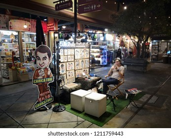 BANGKOK, THAILAND -​ OCTOBER 24,2018:People are traveling and shopping at Asiatique The Riverfront in Bangkok. Asiatique combined two of the most popular shopping experiences a night bazaar and a mall