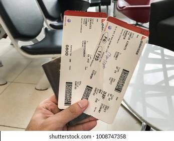 Bangkok / Thailand - October 25 2017: close up woman hand hold Qantas boarding pass with passport at Suvannabhumi airport