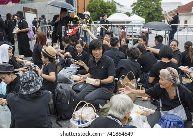 BANGKOK, THAILAND - OCTOBER 25, 2017: Mourners on the streets around Grand Palace attending cremation of King Rama IX in Bangkok, Thailand on October 25, 2017.