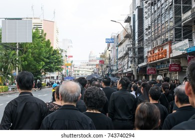 Bangkok, Thailand - October 26, 2017: Crowd of Thais stand on the queue to join the cremation ceremony by offering sandalwood flowers on the cremation day of His Majesty King Bhumibol Adulyadej.