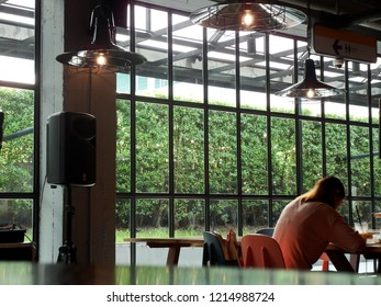 Bangkok/ Thailand - October 26,2018 : Modern lifestyles of young freelancers workers working with their laptops or smartphones in the nice decoration urban co-working space area.