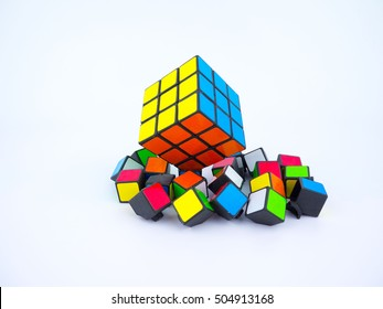 Bangkok, Thailand - October 27th, 2016: Colorful Rubik's cube and broken cube pieces on white background
