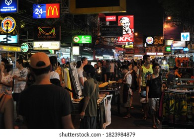 Bangkok, Thailand - October 28, 2012: Tourists walk along a road in backpacker Khao San area. Budget accommodation in Khao San starts from $6 or B200 per night.