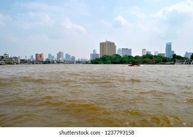 Bangkok, Thailand - October 28, 2013: Traffic on the Chao Phraya River with skyscrapers in the background.