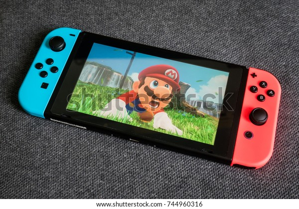 Bangkok, Thailand - October 28, 2017 : Nintendo Switch showing its screen with Super Mario Odyssey game.