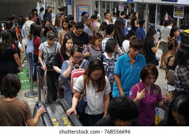 Bangkok Thailand - October 29, 2017: Crowd of passengers using escalator and waiting train, Busy traveling in rush hour at MRT subway train station, Transportation of the Bangkok Mass Rapid Transit