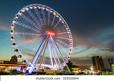 BANGKOK THAILAND - OCTOBER 29 : Ferris Wheel  in ASIATIQUE The Riverfront at twilight time , on October 29, 2015 in Bangkok, Thailand.