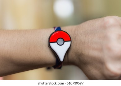 Bangkok, Thailand - October 29: A Pokemon Go player wears the new Pokemon Go Plus on their wrist. Pokemon Go is a free-to-play augmented reality game developed by Niantic for iOS and Android devices.