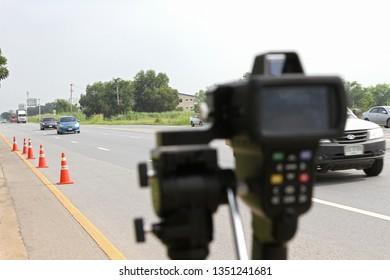 Bangkok, THAILAND - October 3, 2018: Speed Radar Laser Camera Gun Electronic Device Equipment Tool Limit Speed Vehicle Roadway Monitor Display Roadway
