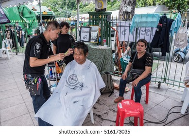 Bangkok, Thailand - October 30, 2016  : Free hair cut for people in funeral of His Majesty King Bhumibol at royal field near Grand Palace in Bangkok.
