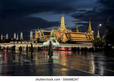 Bangkok, Thailand - October 30 : The Grand Palace was reflection after rain with people in black shirt on October 30, 2016