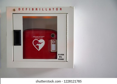 BANGKOK ,THAILAND - October 30,2018 : Heartstart Defibrillator in box on the white wall with First Aid guide for acute cardiac arrest at Bangkok ,Thailand.