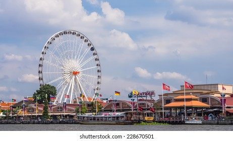 BANGKOK, THAILAND - OCTOBER 31, 2014: Ferris wheel in front of Asiatique The Riverfront. Asiatique is the largest lifestyle outdoor shopping mall in Bangkok by Chao Phraya river.