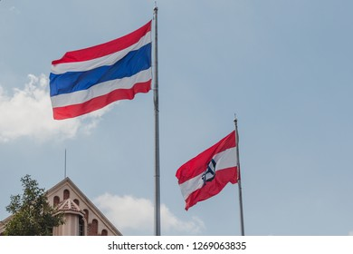 Bangkok, Thailand - October 31, 2015: Thai flag and Assumption College flag at Assumption College with Assumption Cathedral in the background