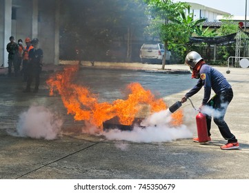 BANGKOK, THAILAND - OCTOBER 31, 2017 : People preparedness for fire drill and training to use a fire safety tank.