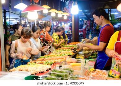 Bangkok, Thailand - October 31, 2019 : Thai street food merchant selling sushi with a lot of people at Tawanna market