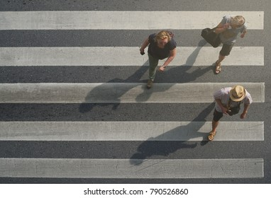 Bangkok Thailand - October 6, 2017: Tourist walking across the crosswalk at the junction street of city, Pedestrian safety, Top view