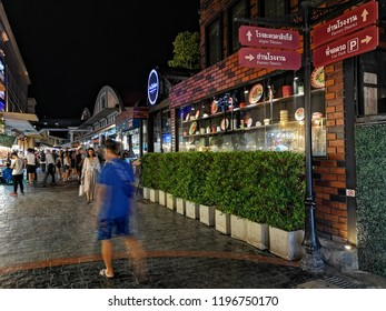 BANGKOK, THAILAND -​ OCTOBER 6, 2018 : People are traveling and shopping at Asiatique The Riverfront in Bangkok. Asiatique combined two of the most popular shopping experiences a night bazaar and mall