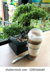 Bangkok, Thailand - October 6 2018 :  ice coffee on the table is in the Cafe Amazon coffee shop with which is business unit from PTT Company is in PTT oil and gas station