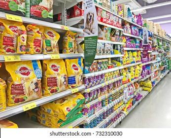 Bangkok, Thailand - October 8, 2017: Selected focus. Shelf of various brand animal feed, pet food, cat food product at Tesco Lotus supermarket. Tesco Lotus supermarket is a big supermarket in Thailand