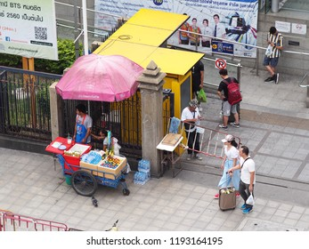 BANGKOK, THAILAND on 7/6/2018: urban city shop keepers business around bus and BTS skytrain station, authentic shot shows common daily life in the business busy hours of the THAI capital city