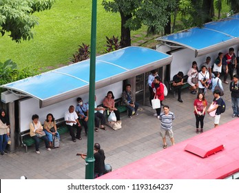 BANGKOK, THAILAND on 7/6/2018: urban city people travelling walking around bus and BTS skytrain station, authentic shot shows common daily life in the business busy hours of the THAI capital city