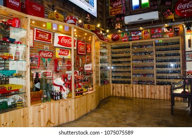 """BANGKOK, THAILAND. – On March 26, 2018 - The coca cola retro product collection in the display shelf at the Coca Cola Museum """"Baan Bang Khen"""""""