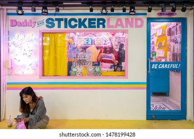 Bangkok, Thailand, Saturday 10 August 2019 : Thai women sitting in front of souvenir sticker shop in Siam square at Lido connect