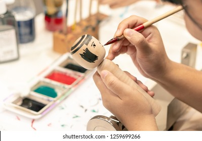 Bangkok, Thailand - SEP 01, 2018 : people making Japanese Kokeshi dolls in the art workshop class, Japan traditional adorable souvenir toys for tourist
