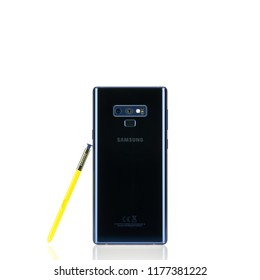 Bangkok, Thailand - Sep 10, 2018: Studio shot of new Samsung Galaxy Note 9 smartphone in ocean blue color with yellow S-Pen stylus, rear camera view, isolated white background. Illustrative editorial.