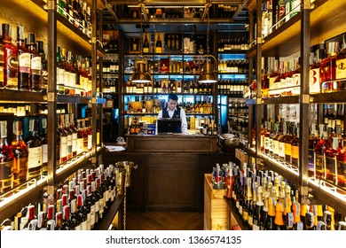 BANGKOK, THAILAND. SEP 14, 2016:  Liquor cellar inside the restaurant with sommerlier at cashier counter for help and giving information.