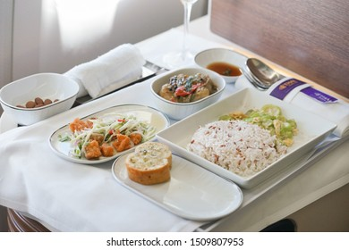 Bangkok, Thailand - Sep 14, 2019 : A photo of in-flight meal Thai dish with rice served for business class passenger of TG664 Thai Airway International, flight from BKK to Shanghai, China. Soft focus.