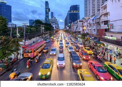 Bangkok, Thailand - Sep. 18, 2018: Traffic jam moves slowly along a busy road in city center in Bangkok. Annually an estimated 150,000 new cars join the heavily congested streets of the Thai capital.