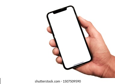 Bangkok, Thailand - Sep 18, 2019: Studio shot of Hand holding Smartphone iPhone 11 Pro Max and Show white screen for  your web site design, logo, app -include clipping path.