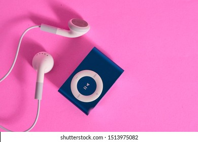 BANGKOK, THAILAND - SEP 22, 2019: Flat lay of iPod shuffle and headphone on pink background with copy space. Apple Inc. Product