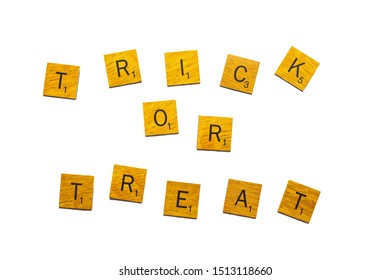 Bangkok, Thailand, Sep 24, 2019 - Trick or treat, Happy Halloween word on wooden texture scrabble letters isolated on white background with clipping path