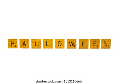 Bangkok, Thailand, Sep 24, 2019 - Halloween word on wooden texture scrabble letters isolated on white background