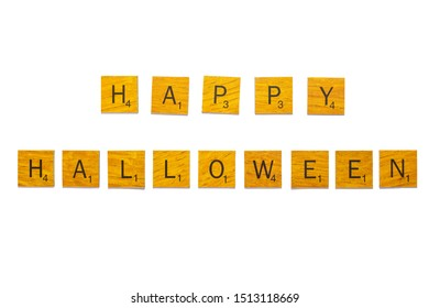 Bangkok, Thailand, Sep 24, 2019 - Happy Halloween word on wooden texture scrabble letters isolated on white background with clipping path