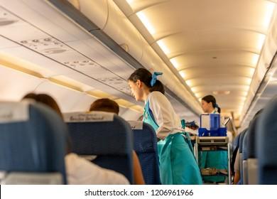 BANGKOK, THAILAND - Sep 27, 2018 - Bangkok Airways flight attendant serve food and drinks to passengers on board