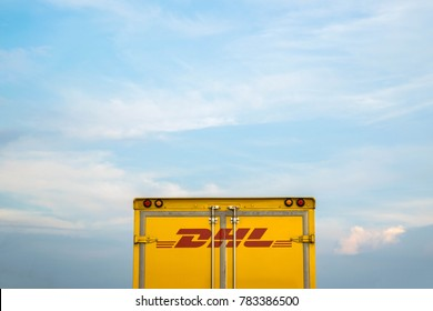 Bangkok, THAILAND - SEP 27: DHL truck with the sky on Sep 27,2017 in Bangkok, Thailand. DHL Express is a division of the German logistics company.