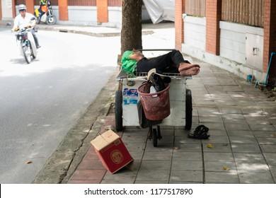 BANGKOK, THAILAND - SEP 3: A homeless person sleeping on a street trolley in the city of Bangkok, Thailand on September 3, 2018.