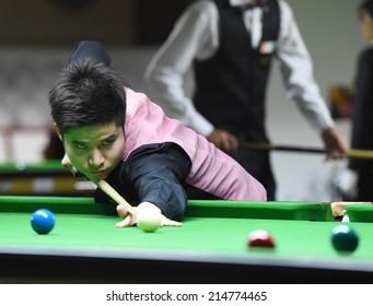 Bangkok, Thailand - SEP 3:Kritsanut Lertsattayathon of Thailand participates in a Sangsom Six-red World Championship 2014 at Montien Riverside Hotel on September 3, 2014 in Bangkok, Thailand.