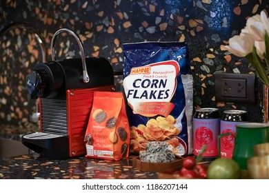 Bangkok, Thailand - Sept 15, 2018 : A photo of grocery, snacks and drinks in the kitchen with selective focus on a bag of a German Hahne Corn Flakes Classic. Beside it is a Waitrose mini jaffa cakes.