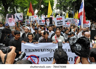 Bangkok, Thailand - Sept 18, 2012: Press photographers jostle for position as a large crowd of Muslims rally outside the American Embassy protesting against the controversial film Innocence of Muslims.