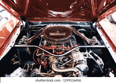 BANGKOK, THAILAND - SEPTBER 20, 2017: Top view of Ford Mustang engine with reflection on chrome and red paint after modify engine and engine dressing. American muscle car and  engine modifications.